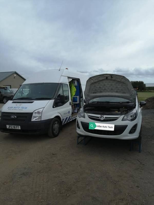 Corsa for service with bonnet open next to Alba Auto Tech van