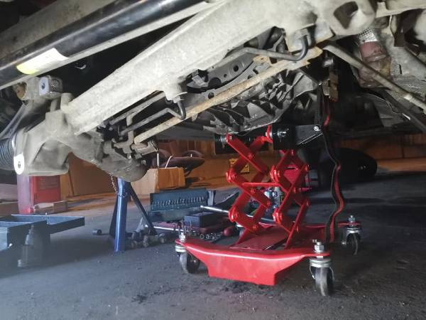Underside of Audi A4 with clutch trolley