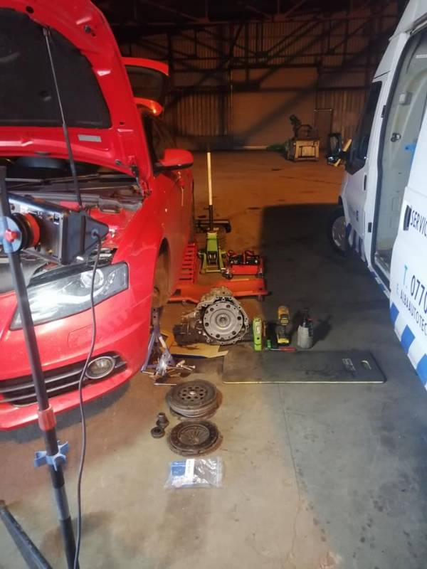 Audi A4 bonnet open awaiting repair, parts on ground